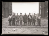 Steel mill workers at skull drop photograph