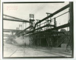 Worker walking tracks at Indiana Harbor coke plant