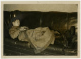 Portsmouth 1937 flood, young man asleep photograph