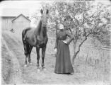 Woman with horse photograph