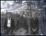Young people seated on bench
