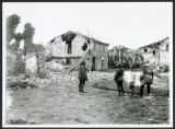 Colonel Hayes near damaged Italian structures