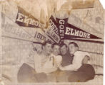 Four men in front of Elmore and Wallace flags