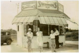Owner of Swenson's Restaurant and family outside first store