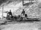 Young mine runners with Jeffrey mining machine