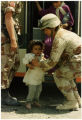 American soldiers with Gulf War refugees