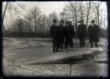 Group of men standing on icy river