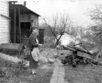 Mrs. Kenneth Rush Feeding Chickens