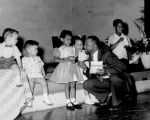 "James Edward ""Eddie"" Saunders Talking with Children"