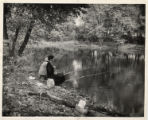 Two women fishing along the Tuscarawas River