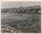 "This photograph shows over 3,000 children performing the ""Shoo Fly Song"" as part of the traditional springtime celebration of May Day at St. Xavier Stadium in Cincinnati."