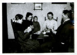 Parks Family Playing Cards at a Small Table Photograph