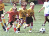Children Playing Soccer Photograph